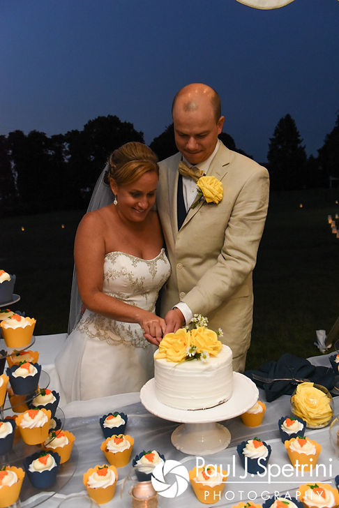 Rebecca and Kelly cut their cake during their August 2017 wedding reception in Warwick, Rhode Island.