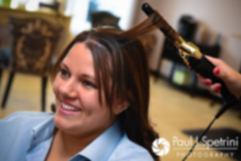 Clarissa has her hair done prior to her June 2017 wedding ceremony at Twelve Acres in Smithfield, Rhode Island.