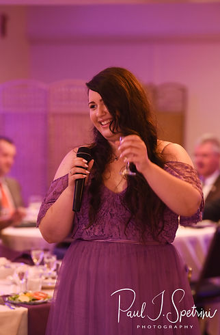 One of the maids of honor gives a toast during Beth & Bryan's August 2018 wedding reception at McGovern's on the Water in Fall River, Massachusetts.