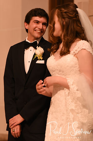 Brian smiles while looking at Sarah during his June 2018 wedding ceremony at the College of the Holy Cross in Worcester, Massachusetts.