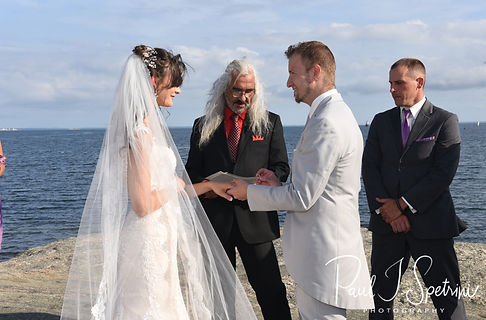 Beth and Bryan exchange rings during their August 2018 wedding ceremony at Fort Phoenix in Fairhaven, Massachusetts.