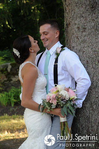 Sean and Cassie pose for a formal photo following their July 2017 wedding ceremony at Rachel's Lakeside in Dartmouth, Massachusetts.