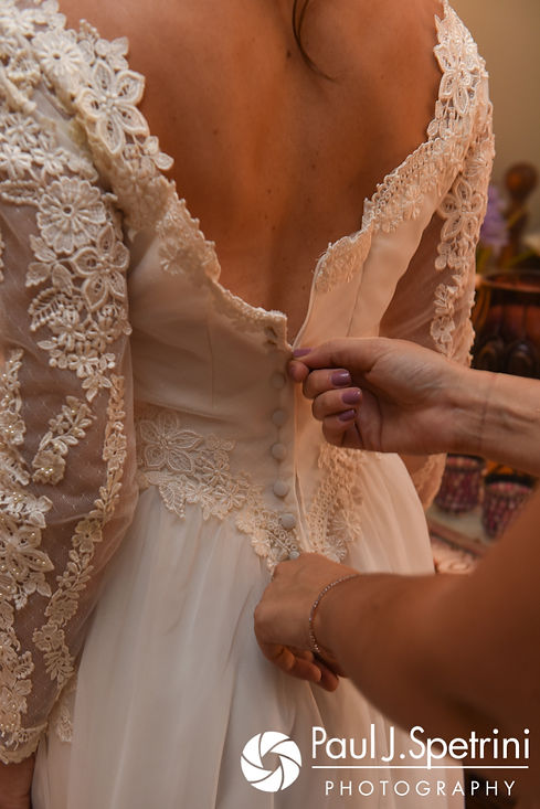 Samantha has her dress zipper up prior to her October 2017 wedding ceremony at St. Robert's Church in Johnston, Rhode Island.