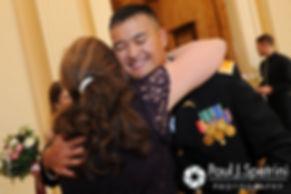 Dan receives a hug during his June 2016 wedding in Providence, Rhode Island.