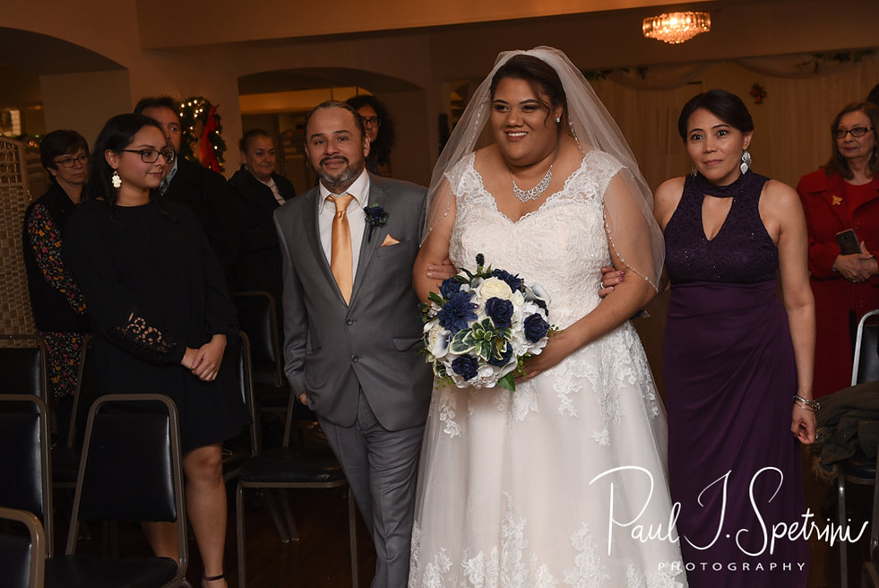 Aileen walks down the aisle during her December 2018 wedding ceremony at McGoverns on the Water in Fall River, Massachusetts.