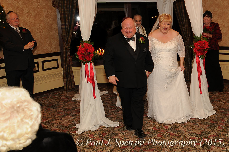 Ron and Cathy are all smiles following their wedding ceremony during their December 2015 Rhode Island wedding at Quidnessett Country Club in North Kingstown, RI.