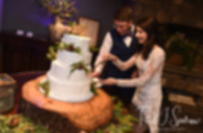 Stacey & Mack cut their wedding cake during their December 2018 wedding reception at Independence Harbor in Assonet, Massachusetts.