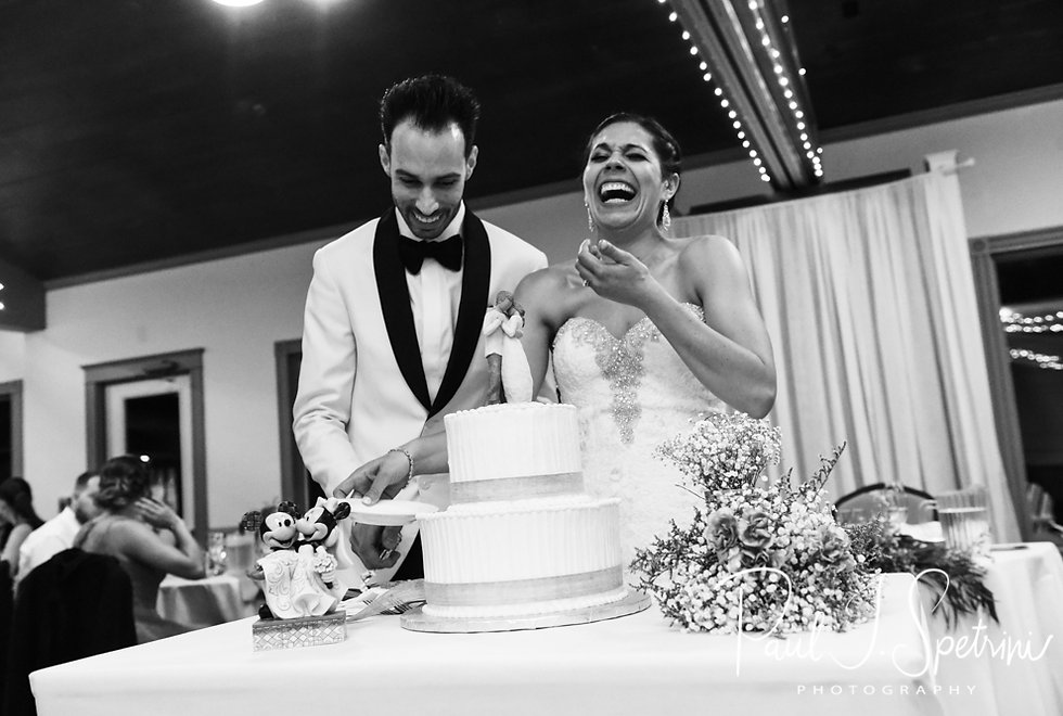 Kendra and Joe laugh during the cake cutting during their May 2018 wedding reception at Crystal Lake Golf Club in Mapleville, Rhode Island.