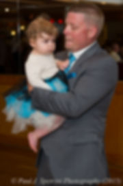 Justin Bolani dances with his daughter during his wedding reception in Bristol, Rhode Island in June 2015.