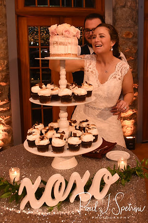 Rob & Allie cut their wedding cake during their October 2018 wedding reception at The Towers in Narragansett, Rhode Island.