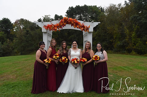 Justine poses for a formal photo with her bridesmaids following her October 2018 wedding ceremony at Twelve Acres in Smithfield, Rhode Island.