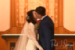 Stacey and Mack kiss during their December 2018 wedding ceremony at St. Teresa's Church in Attleboro, Massachusetts.