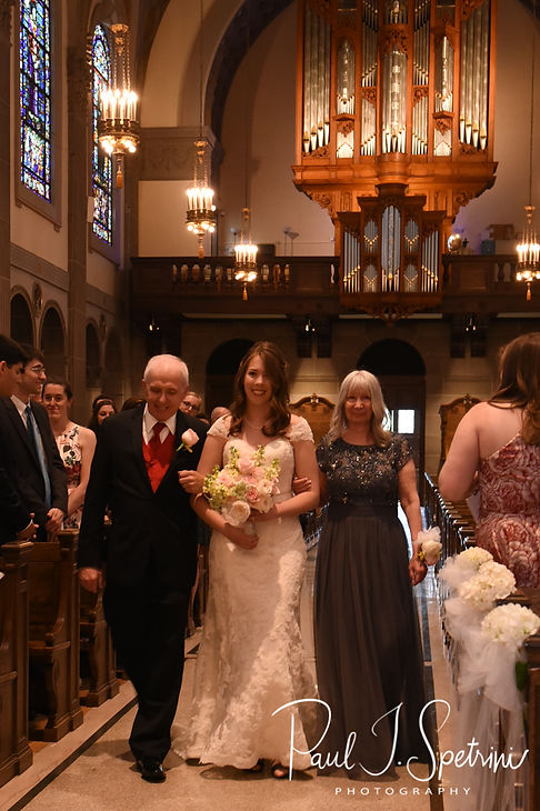 Sarah walks down the aisle during her June 2018 wedding ceremony at the College of the Holy Cross in Worcester, Massachusetts.
