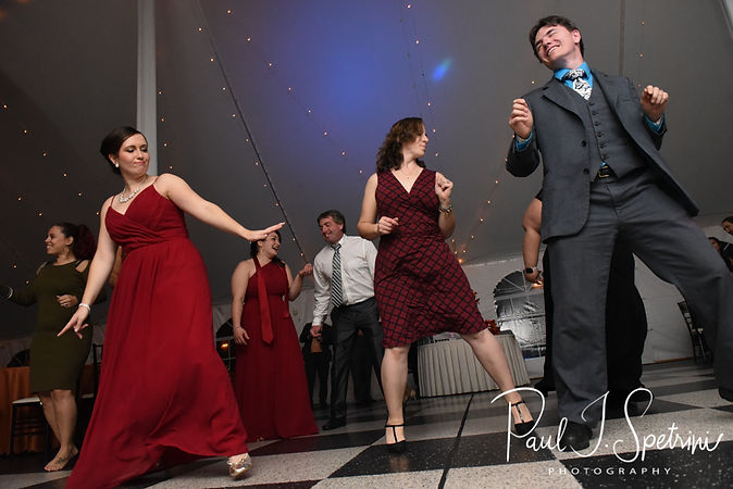 Guests dance during Rich & Makayla's October 2018 wedding wedding reception at Zukas Hilltop Barn in Spencer, Massachusetts.