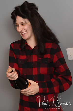 Stacey opens a bottle of champagne during her bridal prep session at in Attleboro, Massachusetts.