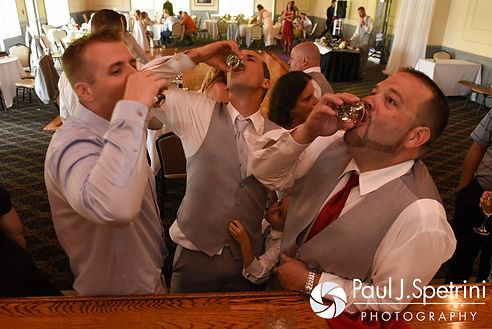 John does a shot with friends during his July 2016 wedding reception at Crystal Lake Golf Club in Burrillville, Rhode Island.