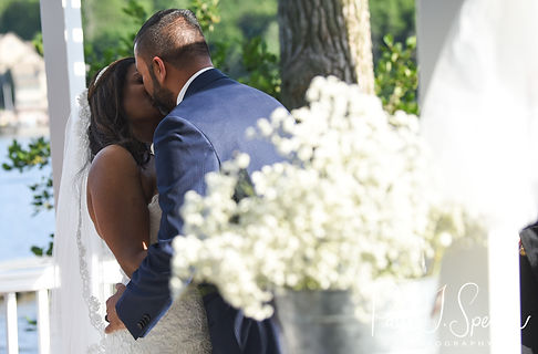 Jimmy and Saken kiss during their July 2018 wedding ceremony at Lake Pearl in Wrentham, Massachusetts.