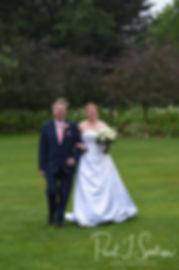 Marijke walks down the aisle during her June 2018 wedding ceremony at Independence Harbor in Assonet, Massachusetts.