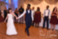 Courtnie and Richardson get ready for their first dance during their August 2018 wedding reception at Emerald Hall in Abington, Massachusetts.