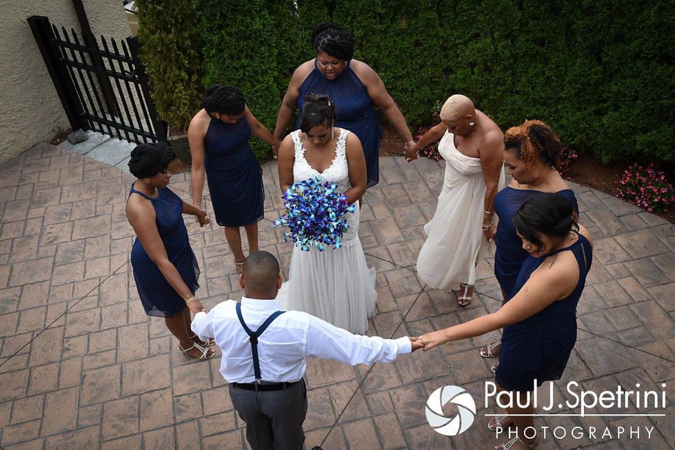 Kemi and her bridesmaids share a prayer prior to her August 2016 wedding reception at the Villa at Riddler Country Club in East Bridgewater, Massachusetts.