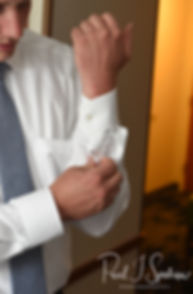 Mike buttons his shirt prior to his May 2018 wedding ceremony at Bittersweet Farm in Westport, Massachusetts.