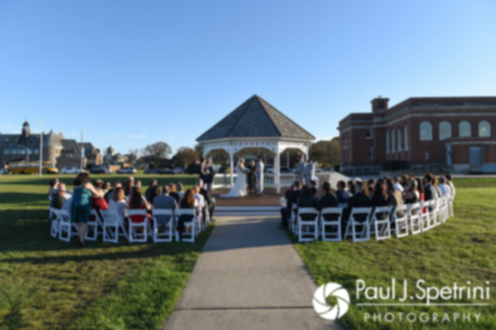Jennifer and Robert listen to their Justice of the Peace during their September 2017 wedding ceremony at Gazebo Park in Narragansett, Rhode Island.