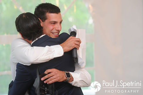 Bruce's best man hugs Bruce during his August 2017 wedding reception at The Inn at Mystic in Mystic, Connecticut.