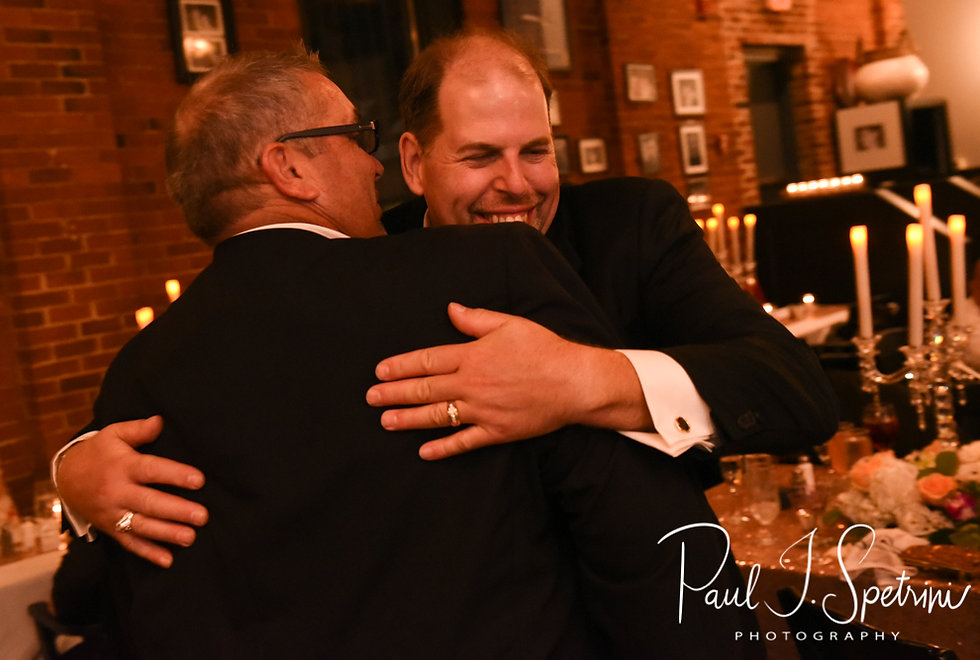 Bob hugs his best man during his August 2018 wedding reception at the Olde Colonial Cafe in Norwood, Massachusetts.