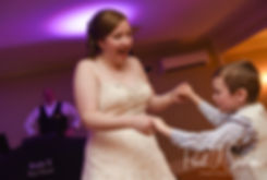 Kaytii's dances with a guest during her May 2018 wedding reception at Meadowbrook Inn in Charlestown, Rhode Island.