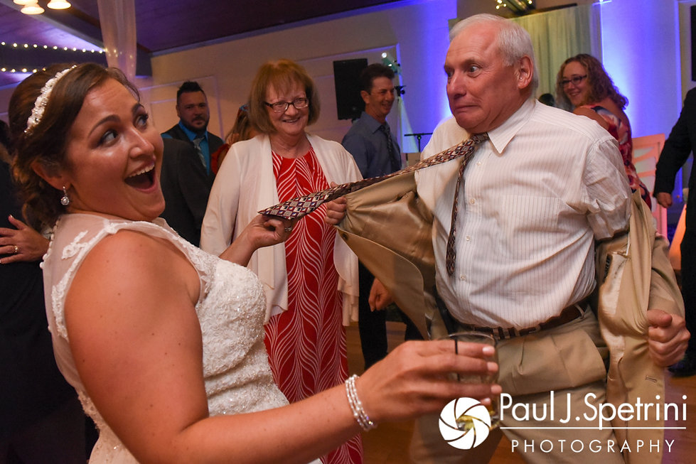 Toni pulls on a guest's tie during her August 2017 wedding reception at Crystal Lake Golf Club in Mapleville, Rhode Island.