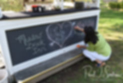 An employee of Meadowbrook Inn works on a sign prior to Nate & Kaytii's May 2018 wedding ceremony at Meadowbrook Inn in Charlestown, Rhode Island.