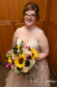 Kelly smiles for a photo prior to her June 2018 wedding ceremony at Blissful Meadows Golf Club in Uxbridge, Massachusetts.