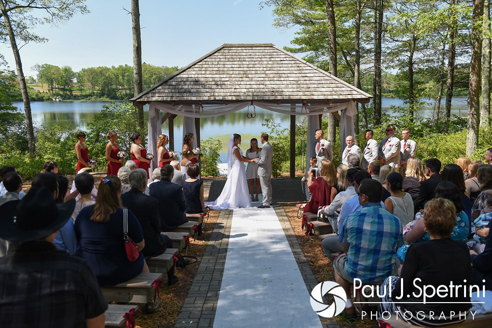 Heather and John hold hands during their July 2016 wedding ceremony at Crystal Lake Golf Club in Burrillville, Rhode Island.