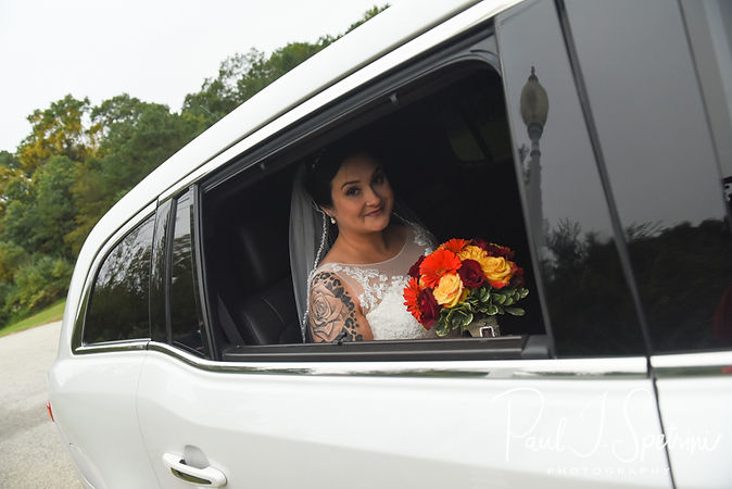 Justine smiles for a photo in the limo prior to her October 2018 wedding ceremony at Twelve Acres in Smithfield, Rhode Island.