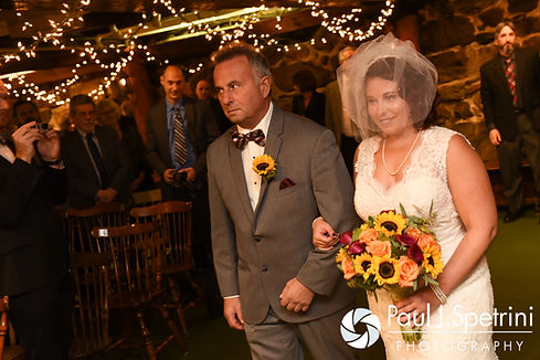 Crystal walks down the aisle with her father during her November 2016 wedding ceremony at the Salem Cross Inn in West Brookfield, Massachusetts.