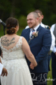 Adam looks at Ashley during his September 2018 wedding ceremony at Stepping Stone Ranch in West Greenwich, Rhode Island.