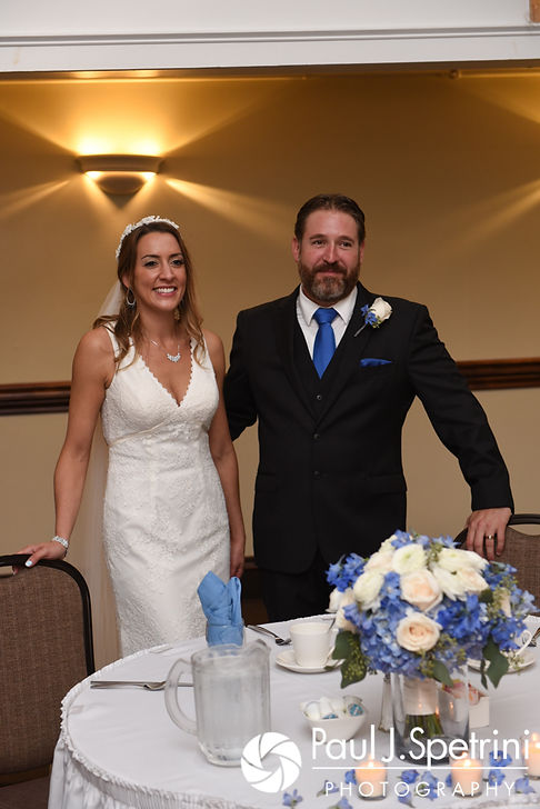 Kevin and Joanna listen to the best man's toast during their October 2017 wedding reception at Cranston Country Club in Cranston, Rhode Island.
