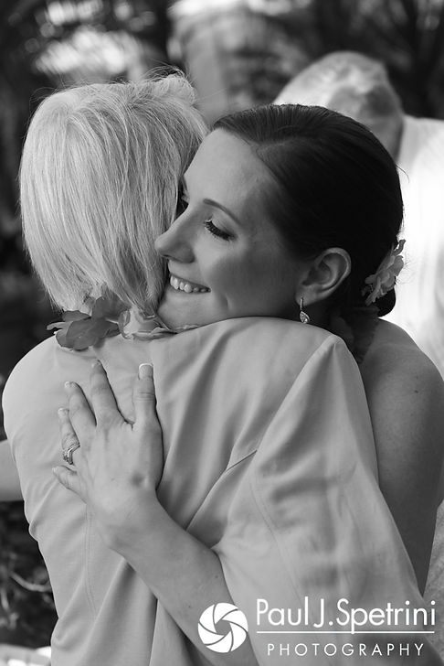 Jess hugs a guest during her May 2017 wedding reception at the Roger Williams Park Botanical Center in Providence, Rhode Island.