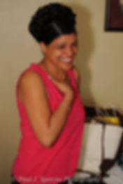 A friend of Jean Andrade reacts to a moment during bridal prep.