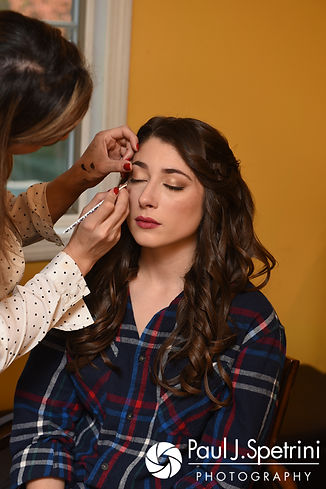 Jessica has her eyelashes fixed prior to her October 2017 wedding ceremony at the Assumption of the Blessed Virgin Mary Church in Providence, Rhode Island.