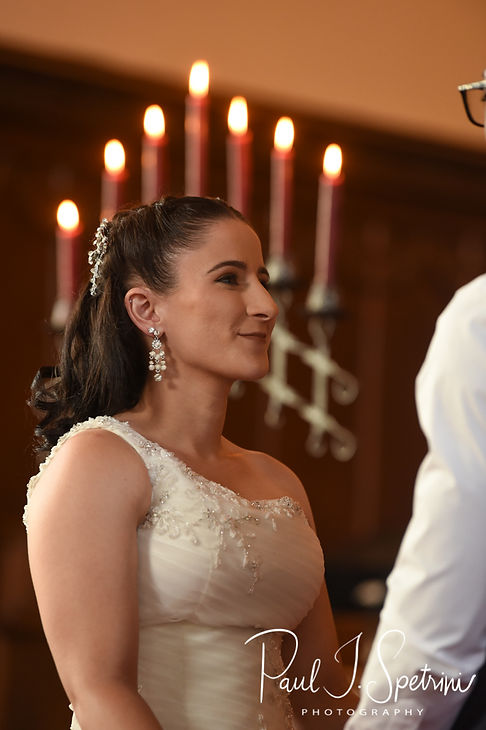 Courtnie smiles during her August 2018 wedding ceremony at Glad Tidings Church in Quincy, Massachusetts.