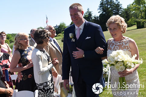 Debbie and her son walk down the aisle during her June 2016 wedding in Barrington, Rhode Island.
