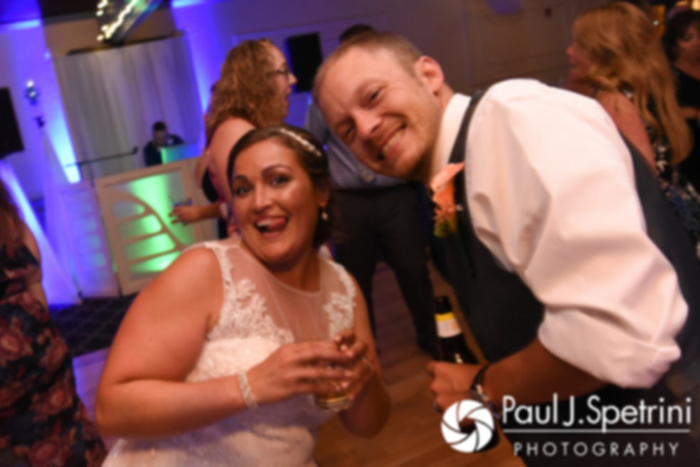 Toni and Scott smile on the dance floor during their August 2017 wedding reception at Crystal Lake Golf Club in Mapleville, Rhode Island.