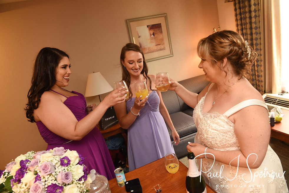 Robin and toasts with her bridesmaids prior to her August 2018 wedding ceremony at Twelve Acres in Smithfield, Rhode Island.