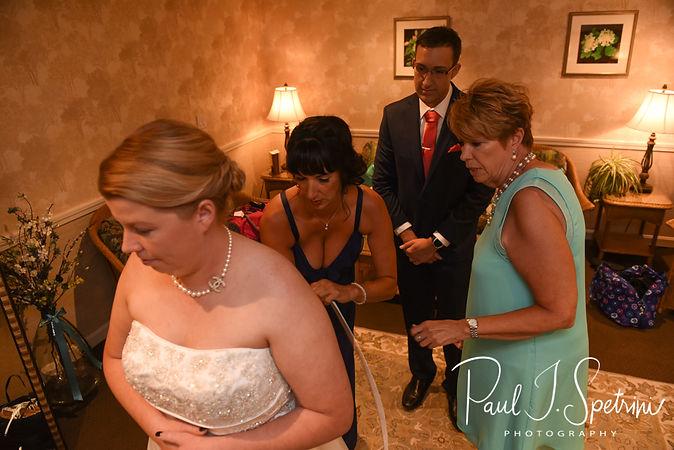 Marijke has her dress zipped up prior to her June 2018 wedding ceremony at Independence Harbor in Assonet, Massachusetts.