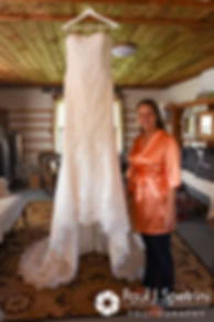 Jennifer stands next to her wedding dress prior to her September 2017 wedding ceremony at Allen Hill Farm in Brooklyn, Connecticut.