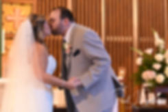 Sarah and Anthony kiss during their October 2018 wedding ceremony at St. Augustine Catholic Church in Providence, Rhode island.