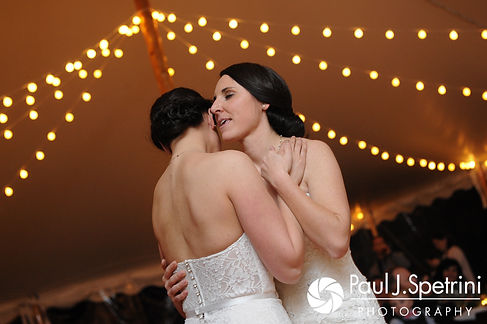 Caroline and Morgan share their first dance during their April wedding reception at the Fort Adams Trust in Newport, Rhode Island.
