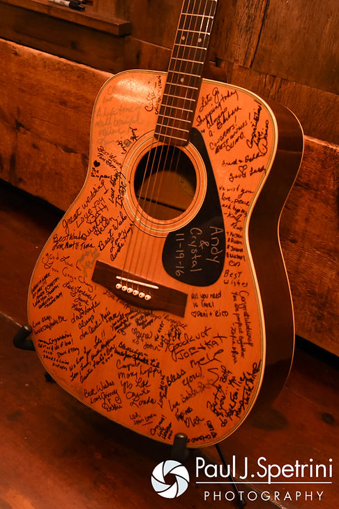 A look at a signed guitar, on display during Crystal and Andy's November 2016 wedding reception at the Salem Cross Inn in West Brookfield, Massachusetts.