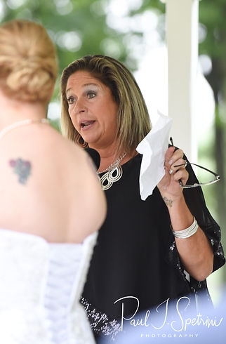 A guest reads during Laura & Marijke's June 2018 wedding ceremony at Independence Harbor in Assonet, Massachusetts.